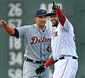 Boston Red Sox designated hitter David Ortiz right and his Detroit Tiger counterpart and former Boston teammate Victor Martinez point in opposite...
