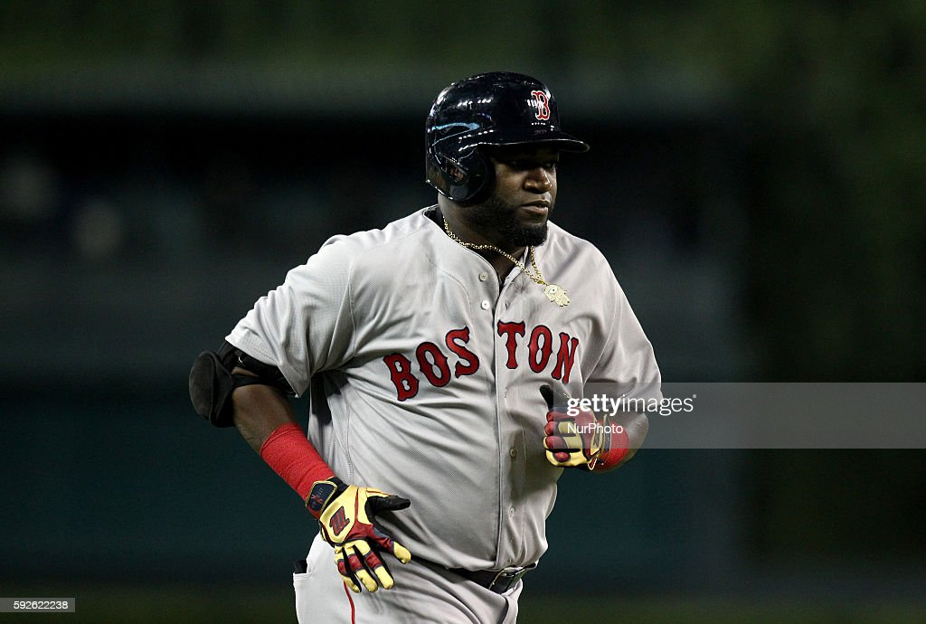 Boston Red Sox designated hitter David Ortiz rounds the bases after hitting atworun home run in the fifth inning of a baseball game against the...