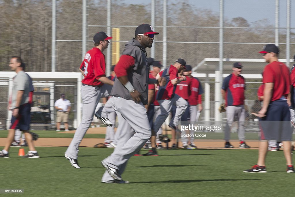 Boston Red Sox designated hitter David Ortiz runs during the stretching portion of spring training at JetBlue Park on Tuesday, Feb. 19, 2013.