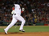 Boston Red Sox designated hitter David Ortiz takes a wide turn past first base after singling in the sixth inning of a game against the Minnesota...