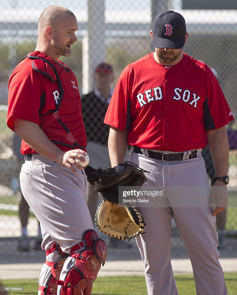 Boston Red Sox designated hitter David Ross works with Jason Varitek, special assistant to the general manager, during spring training at JetBlue Park on Tuesday, Feb. 19, 2013.