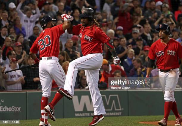 Boston Red Sox designated hitter Hanley Ramirez celebrates with Boston Red Sox left fielder Chris Young after his tworun home run in the third inning...