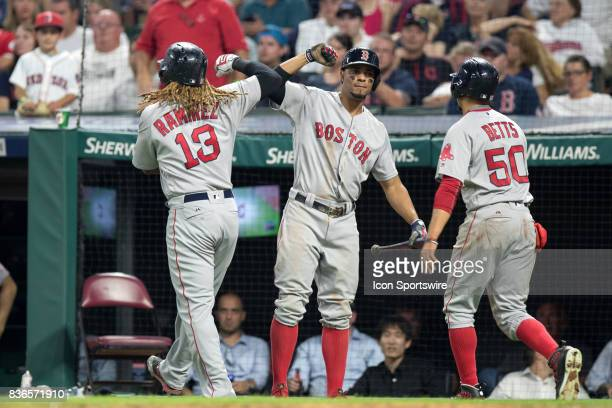 Boston Red Sox designated hitter Hanley Ramirez is congratulated by Boston Red Sox shortstop Xander Bogaerts after hitting a 2run home run during the...