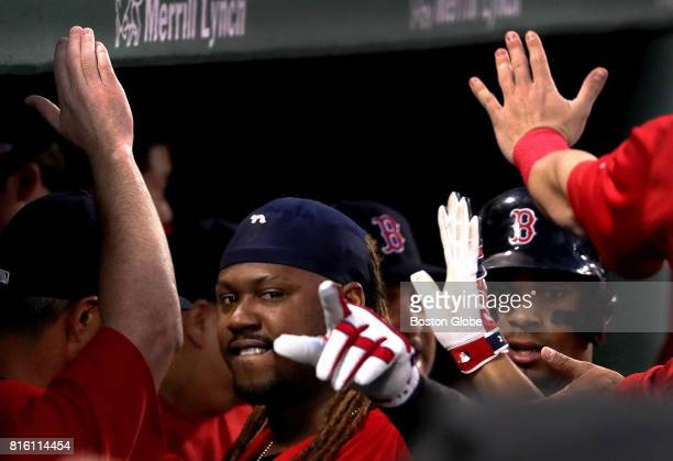 Boston Red Sox designated hitter Hanley Ramirez is congratulated in the Sox dugout after after hitting a tworun home run during the third inning The...