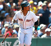Boston Red Sox designated hitter Hanley Ramirez tosses away his bat as he follows the path of his threerun home run in the bottom of the third inning...