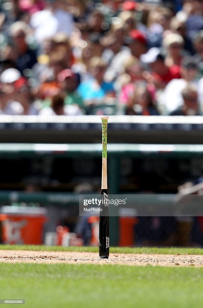 Boston Red Sox designated hitter's bat David Ortiz stands upright during the fourth inning of a baseball game against the Detroit Tigers in Detroit...