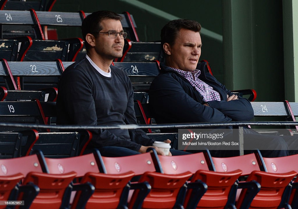 Boston Red Sox Director of Amateur Scouting Amiel Sawdaye, left and General Manager Ben Cherington watch batting team batting practice from the grandstand seats on October 11, 2013 at Fenway Park in Boston, Masschusetts.