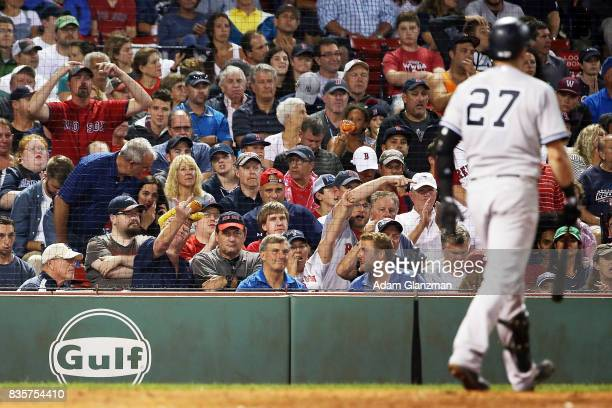 Boston Red Sox fan flips off Austin Romine of the New York Yankees during a game at Fenway Park on August 18 2017 in Boston Massachusetts
