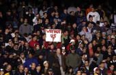 Boston Red Sox fan holds up a sign during game seven of the American League Championship Series against the New York Yankees on October 20 2004 at...