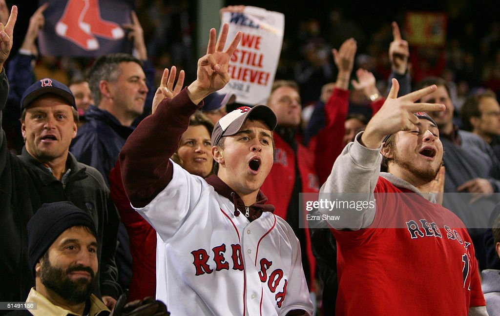 Boston Red Sox fans chat 'three more' after David Ortiz #34 hit the game winning two-run home run against the New York Yankees in the twelth inning during game four of the American League Championship Series on October 17, 2004 at Fenway Park in Boston, Massachusetts.