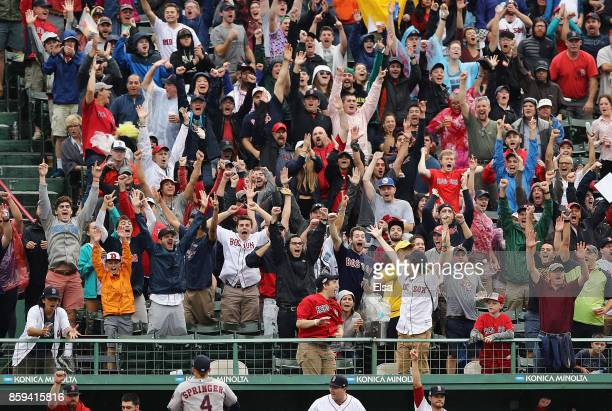 Boston Red Sox fans cheer after a first inning solo home run by Xander Bogaerts of the Boston Red Sox during game four of the American League...