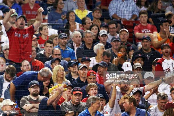 Boston Red Sox fans taunt Austin Romine of the New York Yankees during a game at Fenway Park on August 18 2017 in Boston Massachusetts