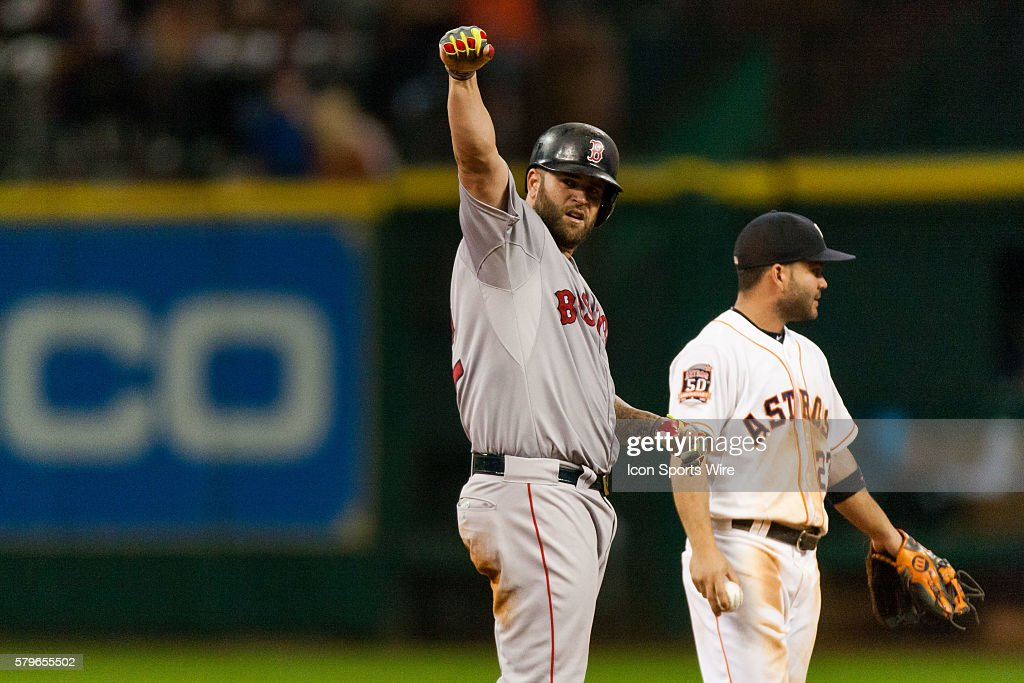 Boston Red Sox first baseman Mike Napoli (12) pumps his fist after hitting a double in the eighth inning of the baseball game against the Houston Astros. Houston Astros defeated Boston Red Sox 5-4 in Houston.