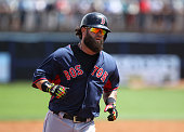 Boston Red Sox first baseman Mike Napoli rounds the bases after hitting a home run against the Tampa Bay Rays during the third inning of a Spring...