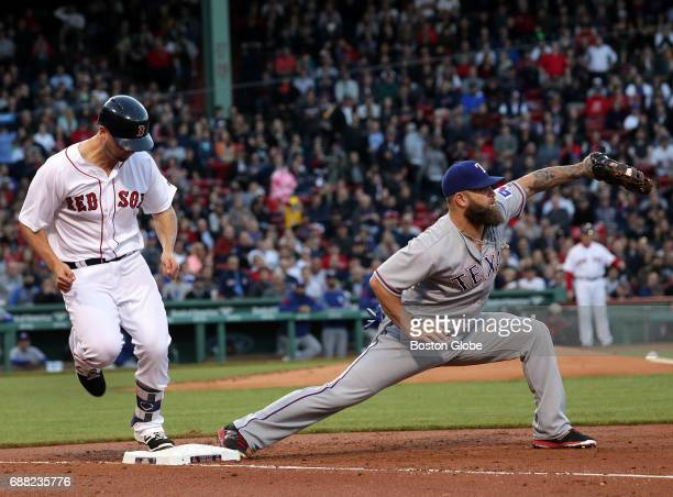 Boston Red Sox first baseman Sam Travis is thrown out at first base on a close play in his first Major League at bat in the third inning The Boston...