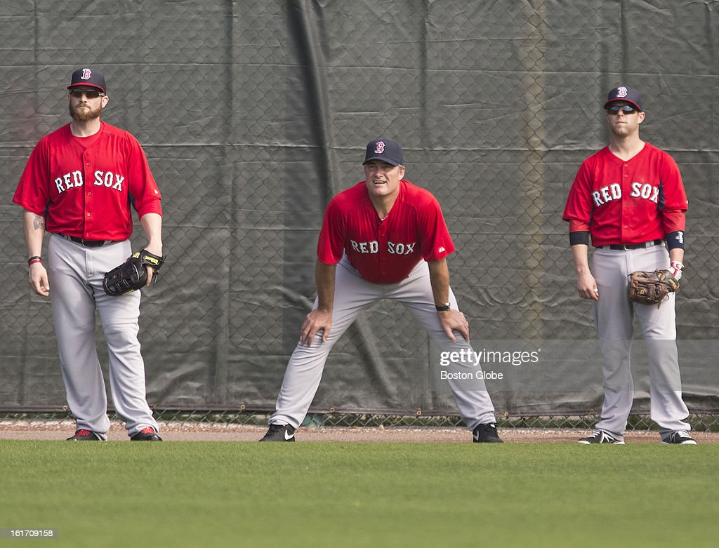 Jonny Gomes, John Farrell and Dustin Pedroia. Day two of spring training at the Red Sox training facilities at JetBlue Park on Wednesday, Feb. 13, 2013.
