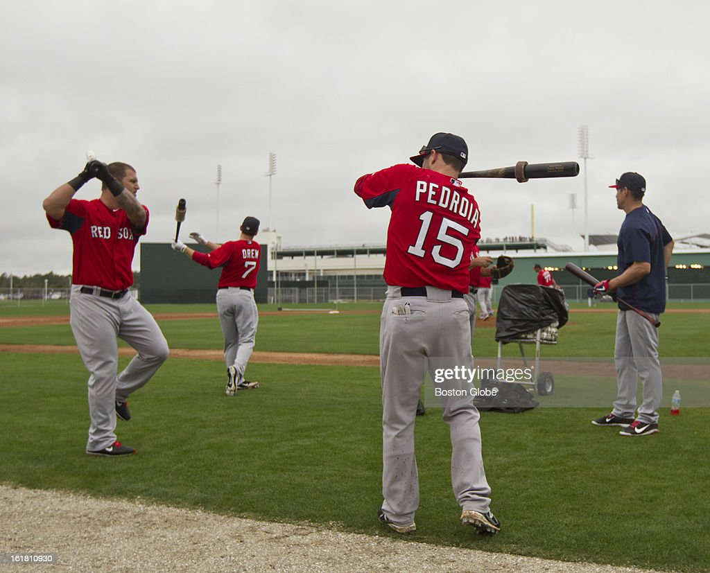 Mike Napoli, Stephen Drew, Dustin Pedroia and Jacoby Ellsbury swings a bat during the first full squad team workout. Day four of spring training at the Red Sox training facilities at JetBlue Park on Friday, Feb. 15, 2013.