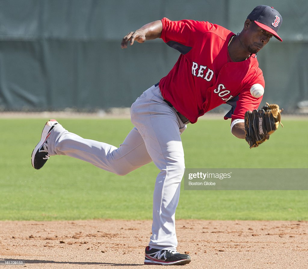 Boston Red Sox infielder Pedro Iglesias bobbles a ground ball. Day two of spring training at the Red Sox training facilities at JetBlue Park on Wednesday, Feb. 13, 2013.