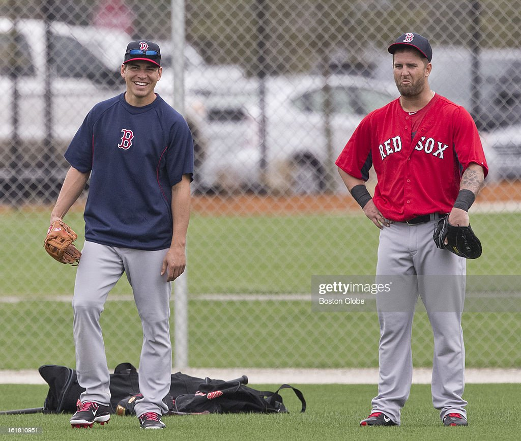 Boston Red Sox Jacoby Ellsbury and Mike Napoli in the outfield during batting practice on the first full squad team workout. Day four of spring training at the Red Sox training facilities at JetBlue Park on Friday, Feb. 15, 2013.