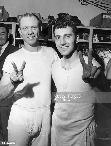 Boston Red Sox Jerry Adair left and Rico Petrocelli right pose for a photo in the locker room after a game at Fenway Park in Boston Oct 1967