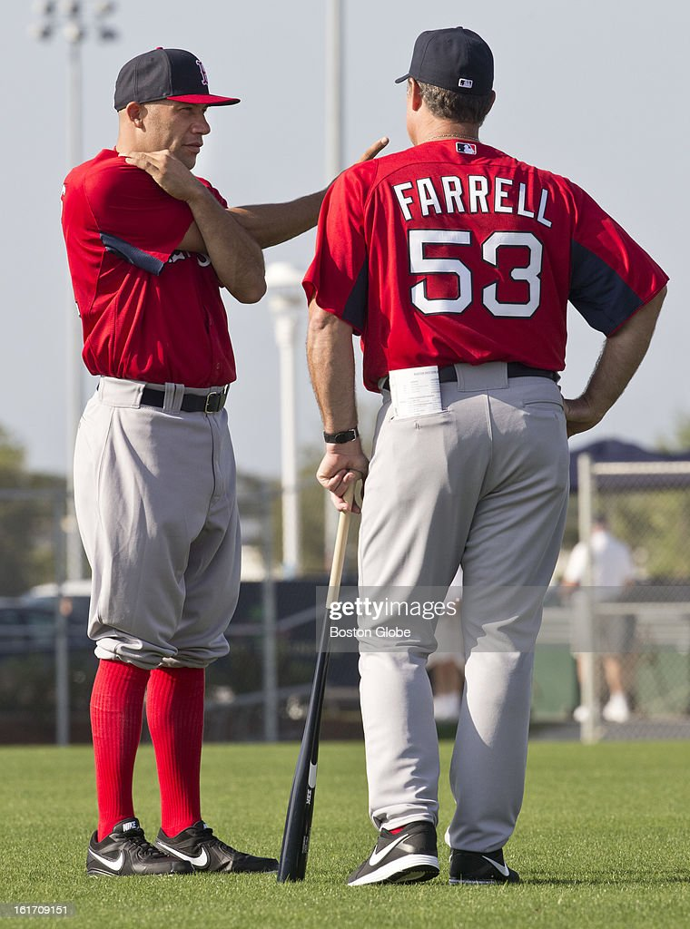 Boston Red Sox John Farrell talking to Alfredo Aceves. Day two of spring training at the Red Sox training facilities at JetBlue Park on Wednesday, Feb. 13, 2013.