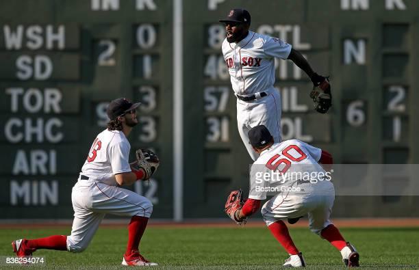 Boston Red Sox left fielder Andrew Benintendi Boston Red Sox right fielder Mookie Betts and Boston Red Sox center fielder Jackie Bradley Jr celebrate...