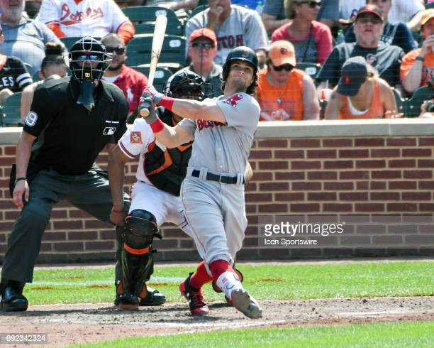 Boston Red Sox left fielder Andrew Benintendi follows the flight of his second home run of the game in the seventh inning against the Baltimore...