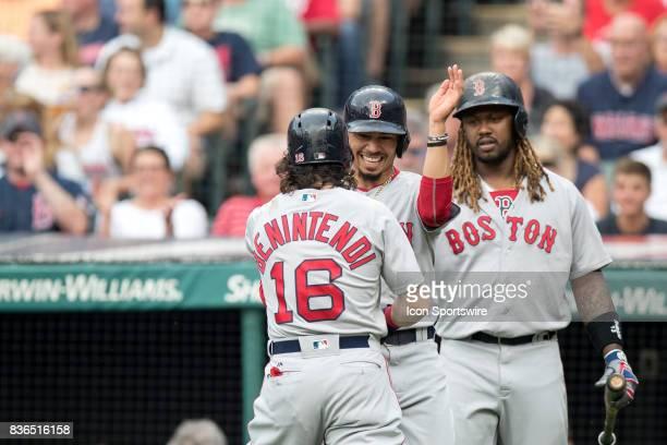 Boston Red Sox left fielder Andrew Benintendi is greeted by Boston Red Sox right fielder Mookie Betts after hitting a 2run home run during the first...