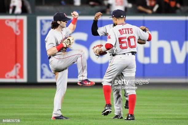 Boston Red Sox left fielder Andrew Benintendi right fielder Mookie Betts and center fielder Jackie Bradley Jr celebrate following an MLB game between...
