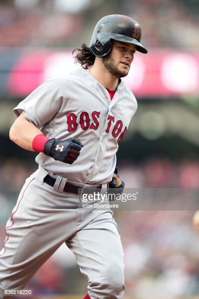 Boston Red Sox left fielder Andrew Benintendi rounds the bases after hitting a 2run home run during the first inning of the Major League Baseball...