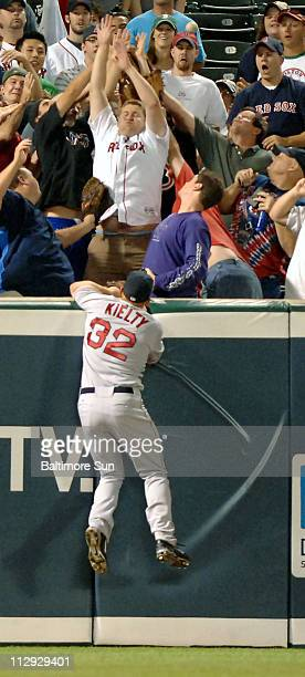 Boston Red Sox left fielder Bobby Kielty tries to no avail to grab a fly ball from Kevin Millar of the Baltimore Orioles in the third inning at...