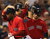 Boston Red Sox left fielder Carl Crawford is congratulated at the plate by Boston Red Sox first baseman Adrian Gonzalez after his three run homer in...