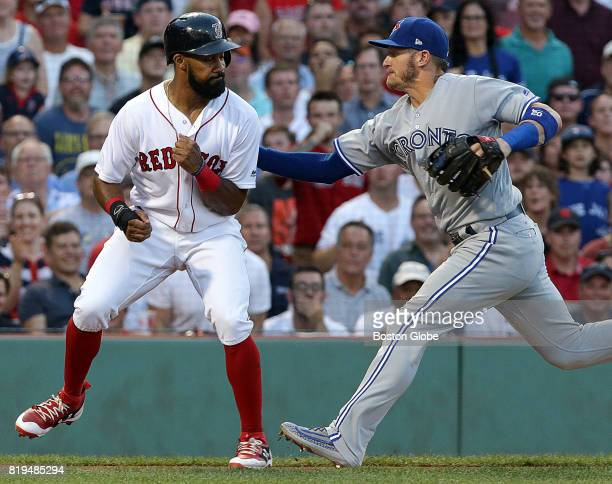 Boston Red Sox left fielder Chris Young is tagged out after being caught in a rundown between home and third base during the second inning The Boston...