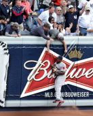 Boston Red Sox left fielder Jackie Bradley slams into the left field wall after making an acrobatic catch of a fly ball by New York Yankees second...