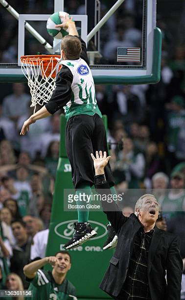 Boston Red Sox manager Bobby Valentine came onto the floor to assist Celtics mascot 'Lucky' with his trampoline springboard dunk attempt that he does...