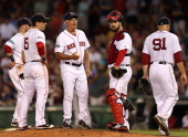 Boston Red Sox manager Bobby Valentine on the mound after Boston Red Sox relief pitcher Alfredo Aceves gave back the lead allowing a three run home...