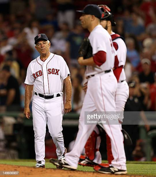 Boston Red Sox manager Bobby Valentine walks to the mound after Boston Red Sox relief pitcher Alfredo Aceves gave back the lead allowing a three run...
