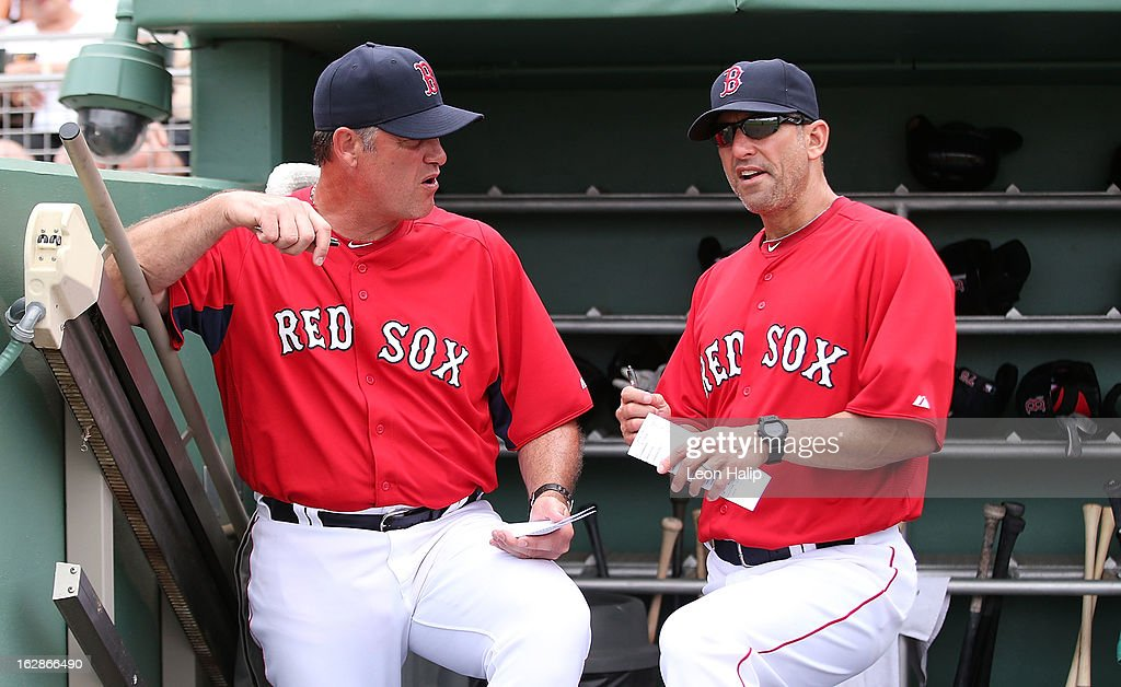Boston Red Sox Manager John Farrell #53 and Bench Coach Torey Lovullo #17 talk during the Spring Training game against the St. Louis Cardinals on February 26, 2013 in Fort Myers, Florida. The Cardinals defeated the Red Sox 15-4.