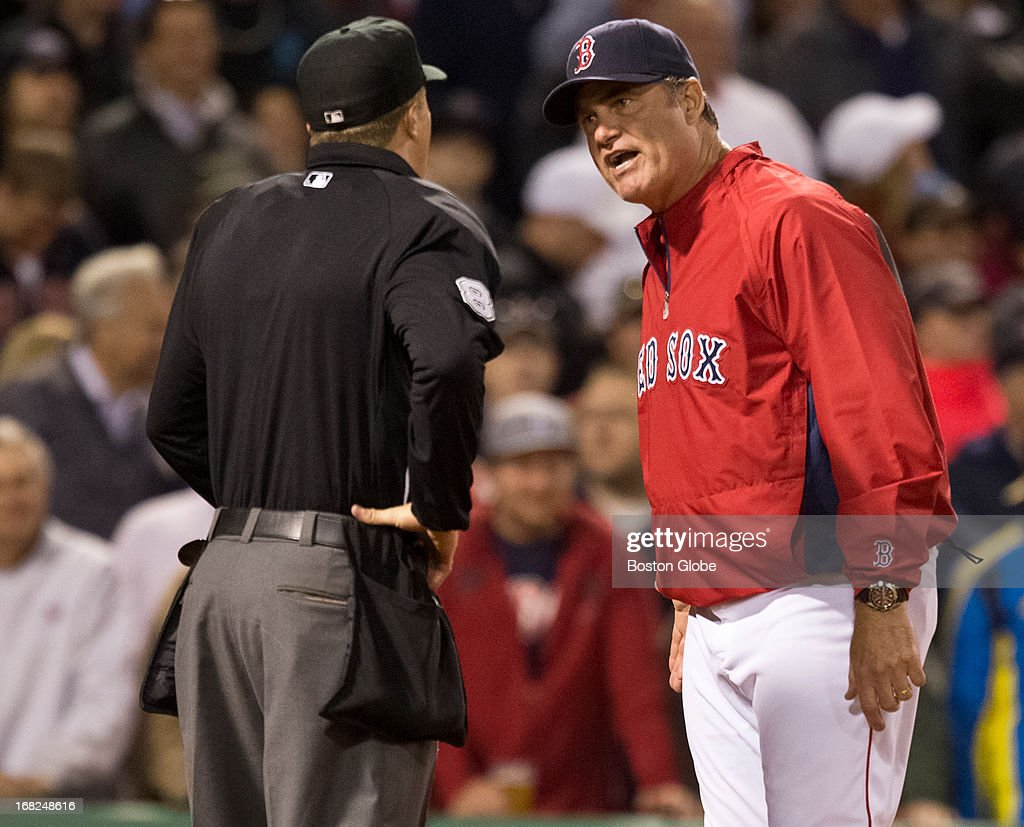 Boston Red Sox manager John Farrell argues with home plate umpire Cory Blaser's call after Stephen Drew was tagged out by Minnesota Twins catcher Joe Mauer during fifth inning action at Fenway Park on Monday, May 6, 2013.