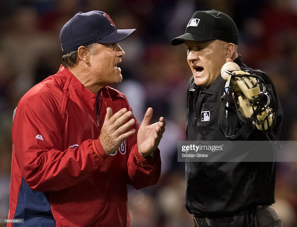 Boston Red Sox manager John Farrell argues with home plate umpire Jeff Nelson after Minnesota Twins player Ryan Doumit ran out of the baseline, impeding the throw from catcher Jarrod Saltalamacchia during eighth inning action at Fenway Park on Tuesday, May 7, 2013.