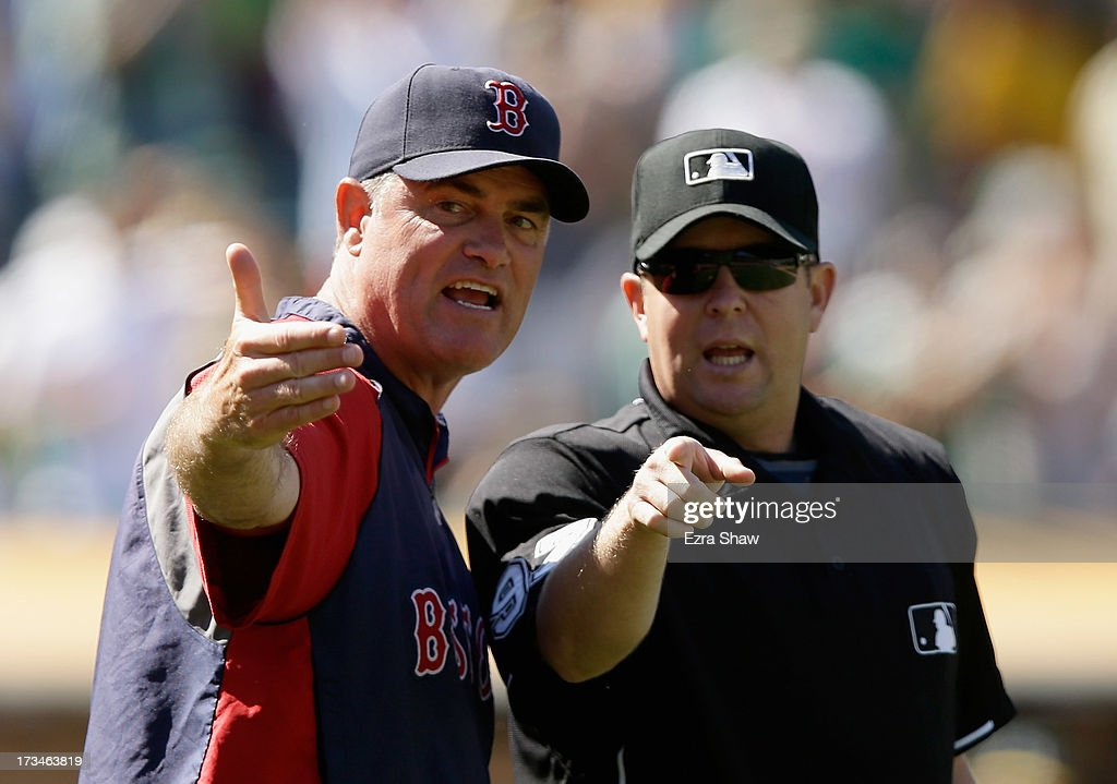 Boston Red Sox manager John Farrell argues with umpire Todd Tichenor after Yoenis Cespedes #52 of the Oakland Athletics was awared second base on a ball that went past the first baseman in the 10th inning of their game at O.co Coliseum on July 14, 2013 in Oakland, California.