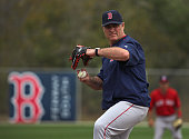 Boston Red Sox manager John Farrell does his best imitation of the Ace pitcher the team is said to be lacking as he takes the mound for base running...