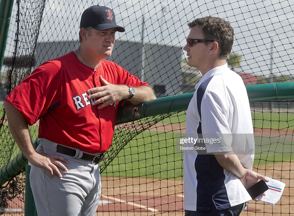 Boston Red Sox manager John Farrell, left, talks to general manager, Ben Cherington. Day two of spring training at the Red Sox training facilities at JetBlue Park on Wednesday, Feb. 13, 2013.