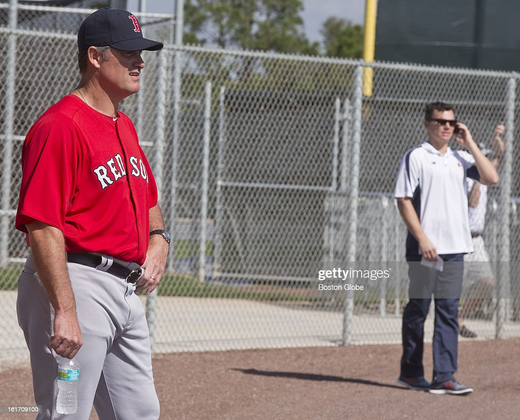Boston Red Sox manager John Farrell, left, watches practice as general manager, Ben Cherington talks on the phone. Day two of spring training at the Red Sox training facilities at JetBlue Park on Wednesday, Feb. 13, 2013.