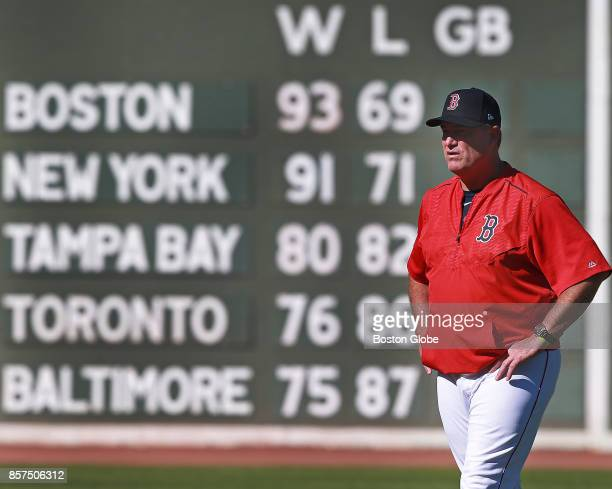 Boston Red Sox manager John Farrell looks on during a practice session at Fenway Park in Boston as the team prepares for their ALDS series against...