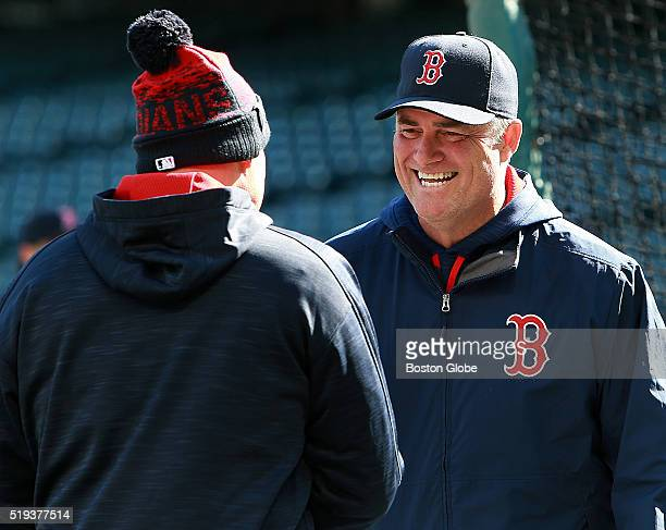 Boston Red Sox manager John Farrell right talks to Brad Mills a current Cleveland Indians coach and former Red Sox bench coach before the first game...