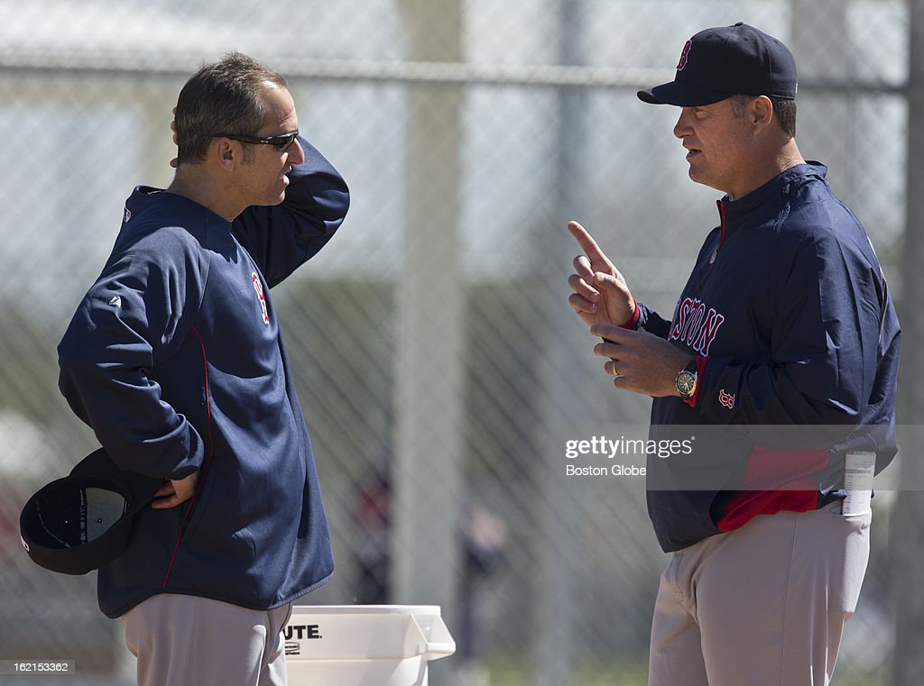 Boston Red Sox manager John Farrell, right, talks to his bench coach Torey Lovullo during spring training at JetBlue Park on Monday, Feb. 18, 2013.
