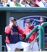 Boston Red Sox Manager John Farrell signals to the first basemen during the game against the Baltimore Orioles at JetBlue Park at Fenway South on...