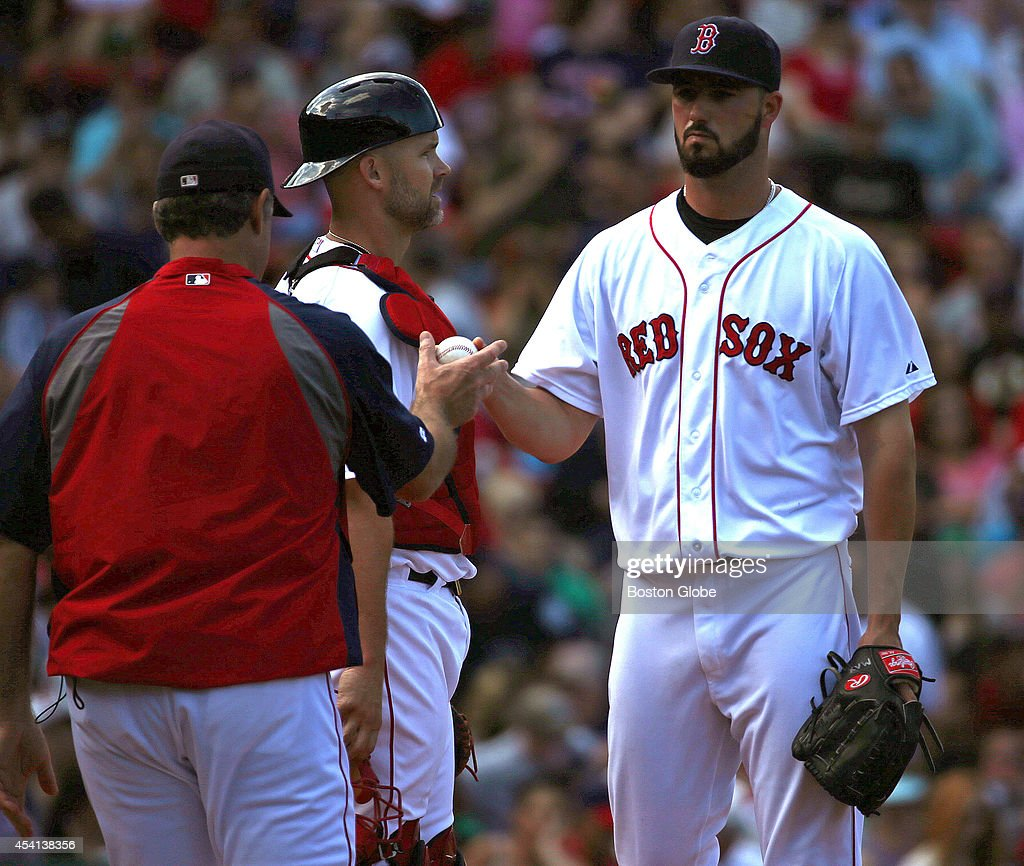 Boston Red Sox manager John Farrell (#53) takes the ball from Boston Red Sox starting pitcher Brandon Workman (#67) in the fourth inning. The Boston Red Sox take on the Seattle Mariners in Game two of a three game series at Fenway Park.