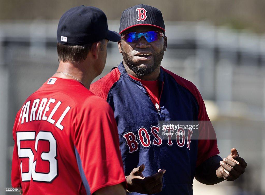 Boston Red Sox manager John Farrell talks to David Ortiz during spring training at JetBlue Park on Wednesday, Feb. 20, 2013.